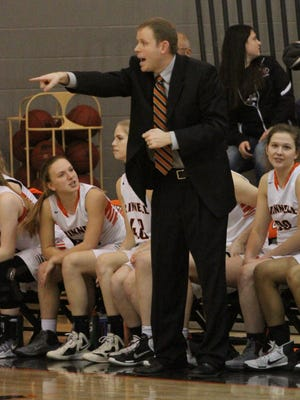 Trent Edsen, Grinnell Tiger girl's head coach, directs the Tiger defense during Grinnell's 64-57 Class 4A-Region 7 final win over Carlisle. The win sends Grinnell to the state championships in Des Moines for the first time in school history.