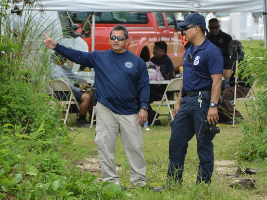 The Guam Fire Department continues searching for a missing fisherman at the Agat cemetery command post on June 10.