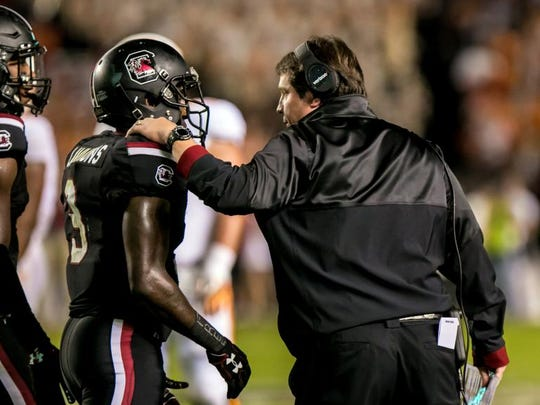 Oct 29, 2016; Columbia, SC, USA; South Carolina Gamecocks head coach Will Muschamp speaks with South Carolina Gamecocks defensive back Chris Lammons (3) after Lammons was ejected against the Tennessee Volunteers in the first quarter at Williams-Brice Stadium. Mandatory Credit: Jeff Blake-USA TODAY Sports