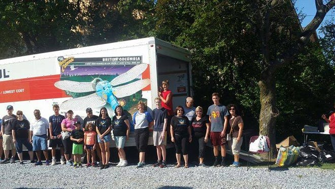 Volunteers at The Unforgotten Haven in Blackwood stand in front of a U-Haul truck, which was filled with goods for flood victims in Louisiana.