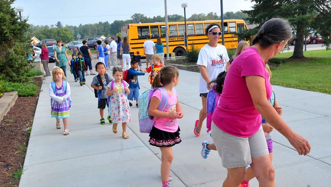 In this Wausau Daily Herald file photo from 2015, Weston students return to their first day of school at Riverside Elementary School. In fall 2017, the D.C. Everest Area School District will add a multi-age elementary school that integrates kids from kindergarten to fifth grade.