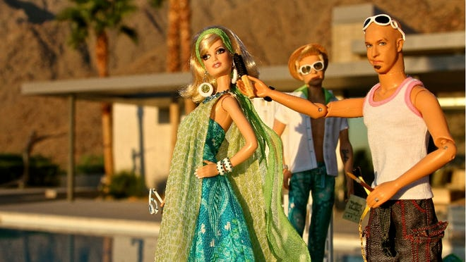 J. Corbett Holmes' MiniMe puts the finishing touches on Barbie's look during a Palm Springs photo shoot.