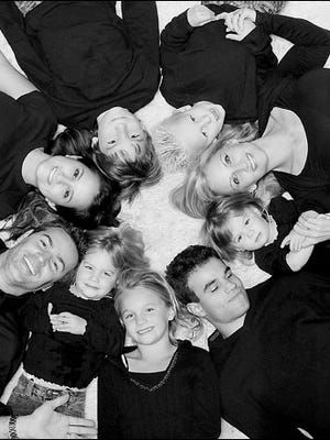 Kurt and Brenda Warner with their seven children.