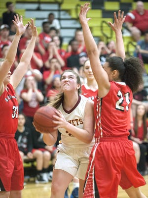 Haddon Heights' Ashley Reynolds, center, puts up a shot between Bound Brook's Olivia Nilsen, left, and Bound Brook's Janeea Summers during Wednesday's state Group 1 semifinal at Deptford.
