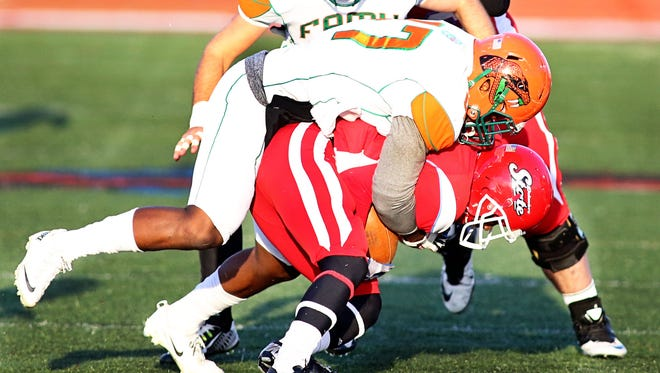 Akil Blount makes a tackle against Delaware State.