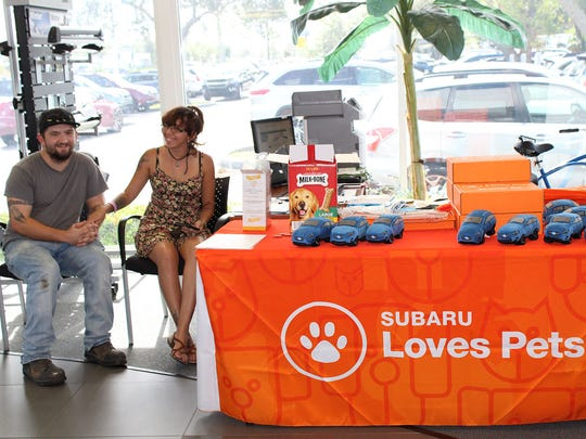 A family waits for their cat adoption to be finalized