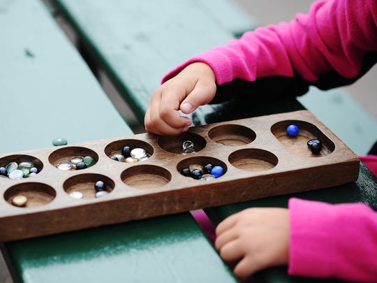 Savanna Fetters, 12, plays mancala on the playground at John F. Kennedy Elementary School in Sioux Falls, S.D.