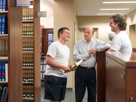 Tom Winston, center, talks with classmates Trey Buckley, left, and Carter Pack during a break in their studies at the University of Tennessee's College of Law on Monday, May 8, 2017. Winston, who is 63, is starting a new career in law after with 40-years in the healthcare industry.