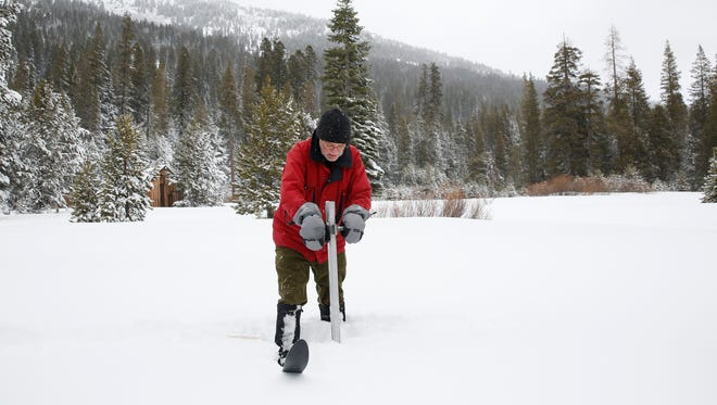 Frank Gehrke, chief of the California Cooperative Snow Surveys Program for the Department of Water Resources, plunges the survey tube into the snowpack as he conducts the first snow survey of the season on Jan. 3 at Phillips Station near Echo Summit, Calif.