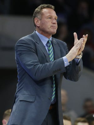 GCU's head coach Dan Majerle claps for his team after scoring against Longwood during the first half at GCU Arena on December 21, 2017 in Phoenix, Ariz.