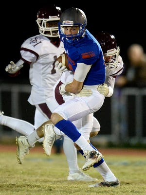 Page wide receiver Michael Burdick (10) is brought down by Spring Hill linebacker Kennedy Ross, right, during the first half of a high school football playoff game on Friday, Nov. 11, 2016, in Franklin, Tenn.