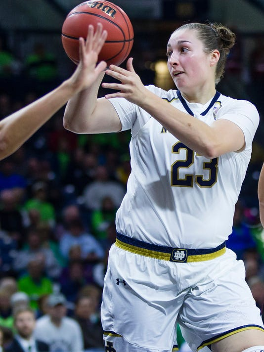 FILE- This Nov., 1, 2017 file photo shows Notre Dame's Jessica Shepard (23) dishing out a pass during an NCAA exhibition college basketball game in South Bend, Ind. One of the first calls that Shepard made when she found out that she was granted immediate eligibility at Notre Dame was to her 90-year old grandfather. He was one of the people to get her into basketball, starting when she was three years old. Lately, he's been the one who was calling her every day to see if the waiver that would let her play at Notre Dame without sitting out a year had been granted by the NCAA. (Michael Caterina/South Bend Tribune via AP)