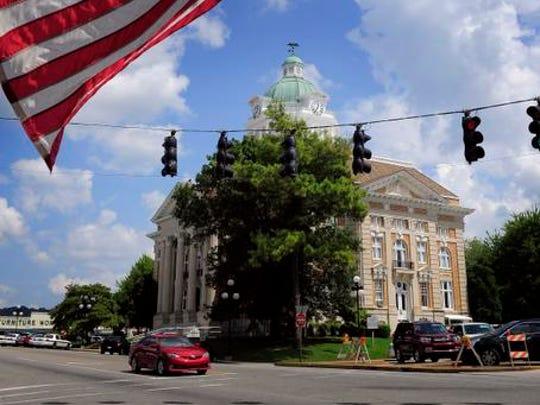 An American flag flies near the courthouse Friday Sept. 5, 2014, in Pulaski, Tenn.