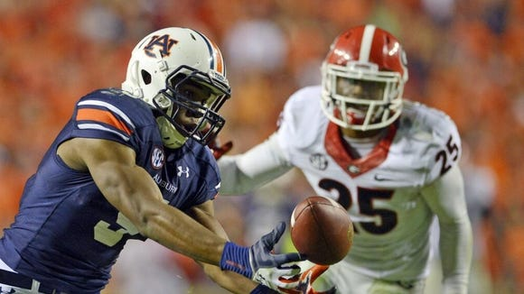 Ricardo Louis caught Nick Marshall's Hail Mary pass on fourth down for a touchdown to give the Tigers a 43-38 win against Georgia.