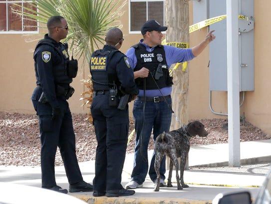Federal investigators work the scene of a bomb scare