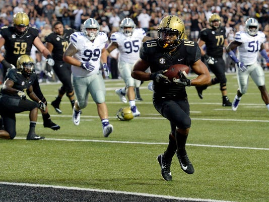 Vanderbilt wide receiver C.J. Duncan (19) runs into the end zone to score a touchdown on a 3-yard pass reception against Kansas State in the first half of an NCAA college football game Saturday, Sept. 16, 2017, in Nashville, Tenn. (AP Photo/Mark Zaleski)