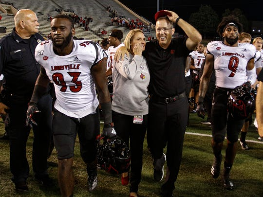 Louisville coach Scott Satterfield and his wife, Beth, leave the field after Louisville defeated Wake Forest 62-59 in an NCAA college football game in Winston-Salem, N.C., Saturday, Oct. 12, 2019. (AP Photo/Nell Redmond)