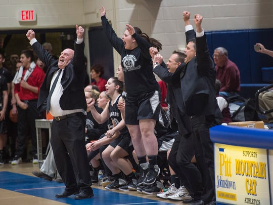 Homer Center's basketball team celebrates as they win the PIAA Class A girls first round playoffs against Southern Fulton in Johnstown, Pa. on Saturday, March 5, 2016 Homer Center defeated Southern Fulton 47-46.