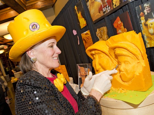 """Jungle Jim's Big Cheese Festival took place this weekend with cheese offerings from all over the world paired with fine beers, ciders and wine. """"The Cheese Lady,"""" Sarah Kaufman of San Diego, sculpts figures from blocks of cheese."""