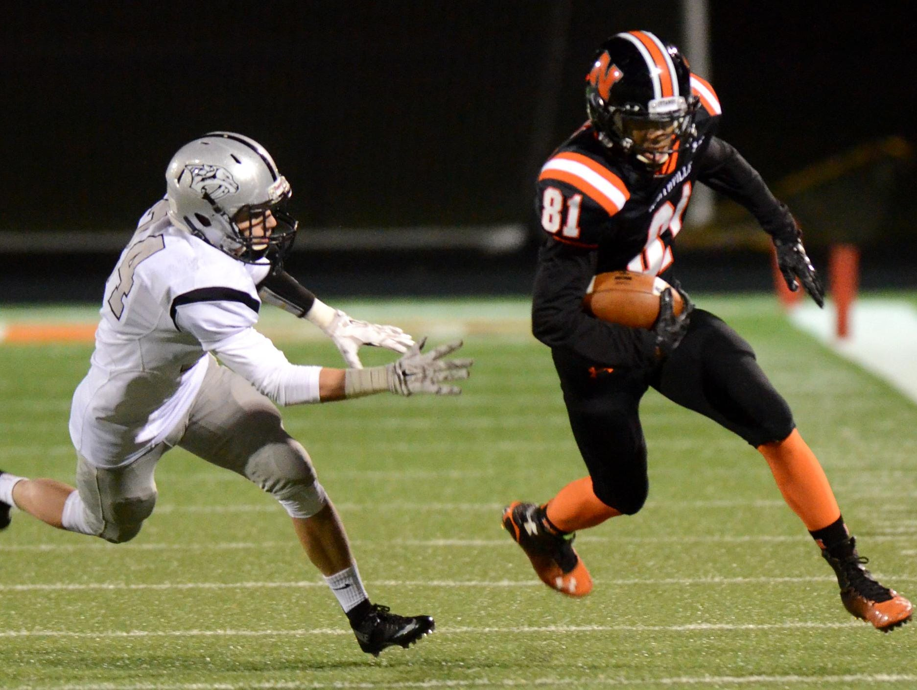 Plymouth's Joey Ahearn (left) tries to chase down Northville's Anthony Abbott.