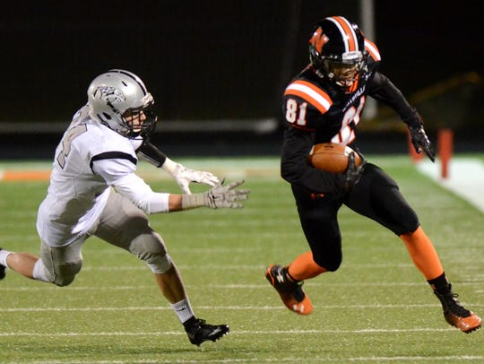 Plymouth's Joey Ahearn (left) tries to chase down Northville's