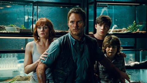 """This photo provided by Universal Pictures shows, Bryce Dallas Howard, from left, as Claire, Chris Pratt as Owen, Nick Robinson as Zach, and Ty Simpkins as Gray, in a scene from the film, """"Jurassic World,"""" directed by Colin Trevorrow, in the next installment of Steven Spielberg's groundbreaking """"Jurassic Park"""" series. The Universal Pictures 3D movie releases in theaters on June 12, 2015. (Universal Pictures/Amblin Entertainment via AP)"""