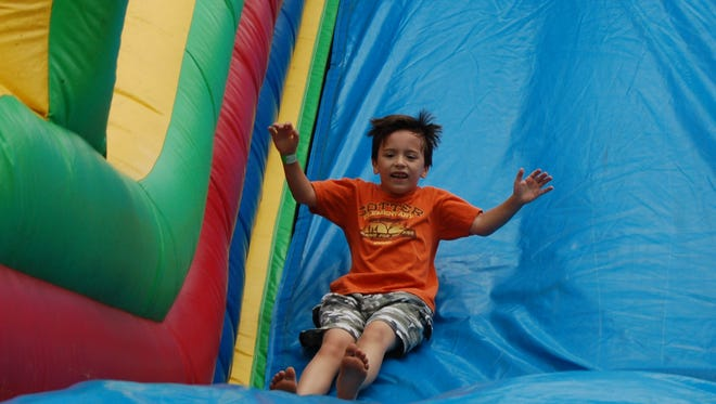 A giant slide is just one of several inflatables that will be on hand for children at Saturday's Gassville in the Park.
