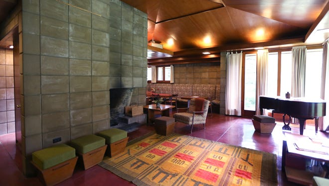 Hand-made concrete blocks in the center with a large open natural fireplace.