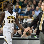 Fran McCaffery sounded excited Friday, and with good reason. His star (Peter Jok, left) is returning for 2016-17.