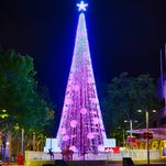 The largest display of Christmas lights on an artificial tree was illuminated on Friday in downtown Canberra, Australia. Guinness World Records confirmed that Australian David Richards broke the record for the most lights on an artificial tree with his latest holiday lights project.