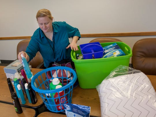 Sunshine Ratliff boxes up donated items that will be sent to area foster youth now attending college Thursday, Jan. 14, 2016 at St. Clair County Department of Human Services. The College Basket Program is in need of donations for February baskets.