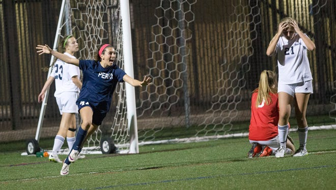 Perry High midfielder Kambree Meskill (47) celebrates her goal against Pinnacle High during overtime of the Division I girls soccer tournament at Xavier College Prep on February 2, 2015.
