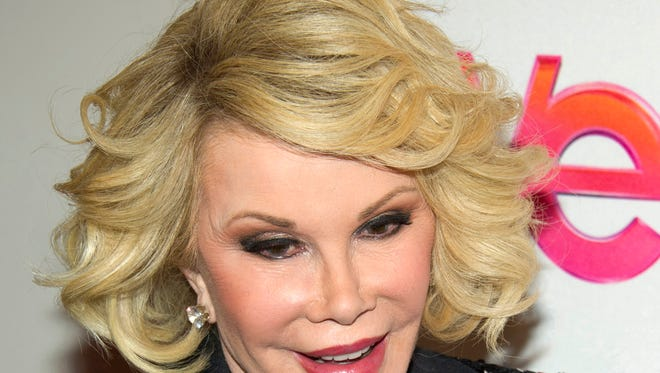 """FILE - In this Jan. 19, 2012, file photo, Joan Rivers attends a screening of the Season 2 premiere of WE TV's """"Joan & Melissa: Joan Knows Best?"""" in New York. Two police officials say Rivers has been rushed in cardiac arrest from a doctor?s office to a New York City hospital, Thursday, Aug. 28, 2014."""