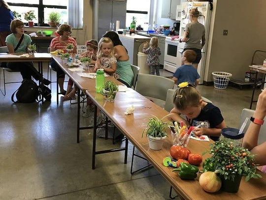Children in the Flower Buds class learn about foods