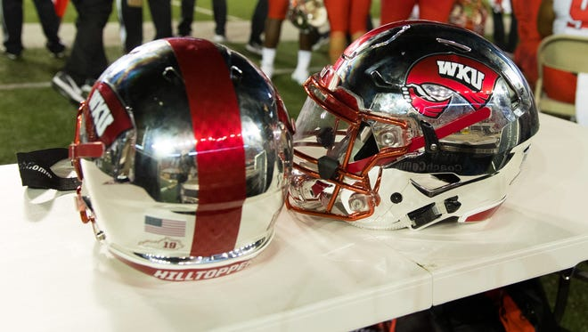 Aug 31, 2018; Madison, WI, USA; Western Kentucky Hilltoppers helmets sit on the sidelines during the game against the Wisconsin Badgers at Camp Randall Stadium. Mandatory Credit: Jeff Hanisch-USA TODAY Sports