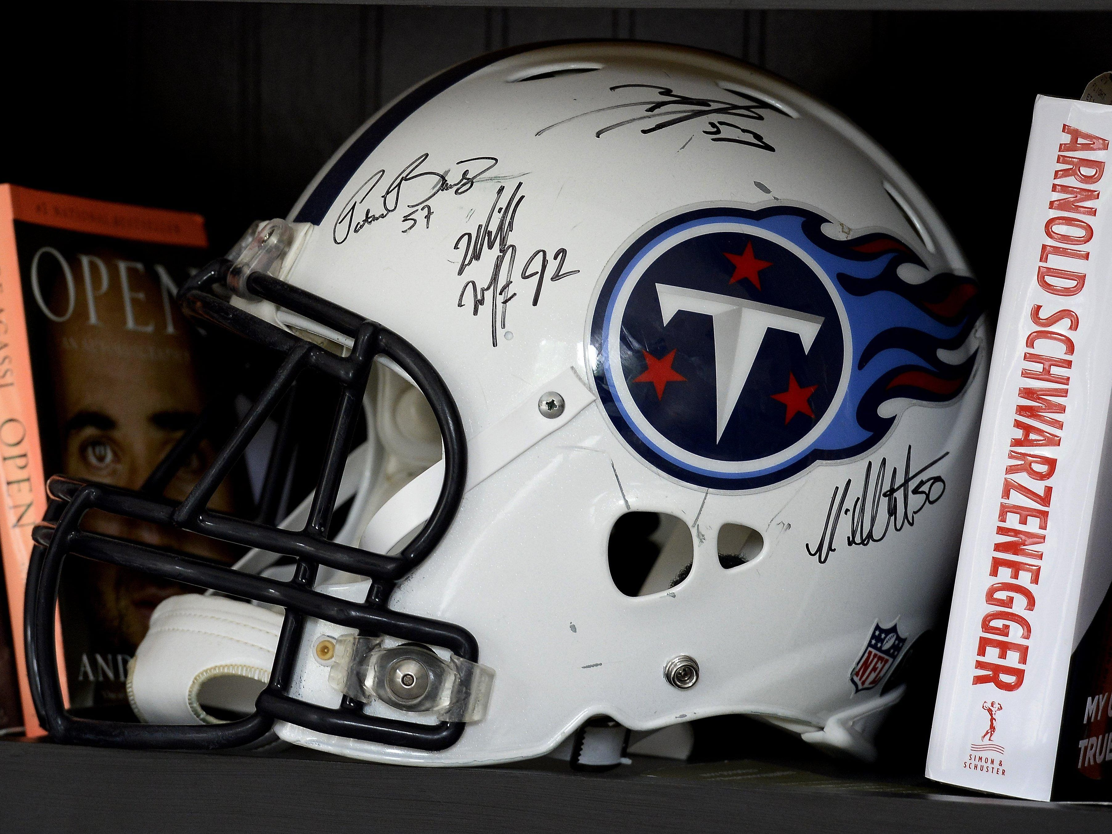 An autographed helmet from the Tennessee Titans is on a bookshelf at Shaw's home. The linebacker finished his NFL career as a Titan.