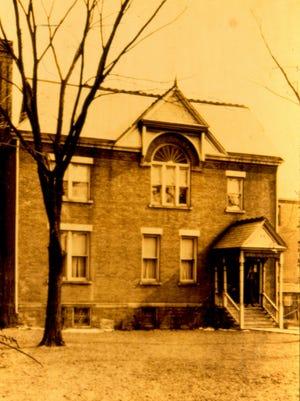 The brick house pictured in 1922  was 214 W. Gray St. It was purchased in 1909 serving as the Christian Science church until 1924.