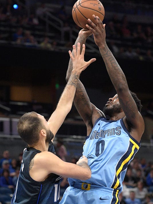 Memphis Grizzlies forward JaMychal Green (0) goes up to shoot in front of Orlando Magic guard Evan Fournier, left, during the first half of an NBA basketball game Saturday, March 3, 2018, in Orlando, Fla. (AP Photo/Phelan M. Ebenhack)