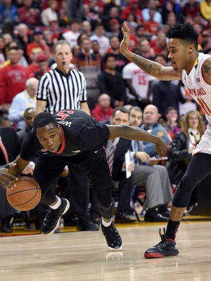 Rutgers guard Mike Williams (5) tries to control the ball against Maryland guard Jared Nickens (11) during the first half of an NCAA college basketball game Wednesday, Jan. 6, 2016, in College Park, Md. (AP Photo/Nick Wass)