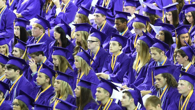 Members of the 2015 Waukee graduating class attend the ceremony on Monday, May 18, 2015, at Drake University's Knapp Center.