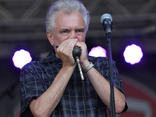 Harmonica player Jim Liban is one of three local blues