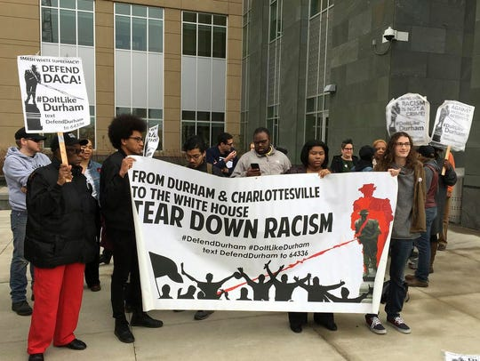 Supporters await defendants who toppled a Confederate