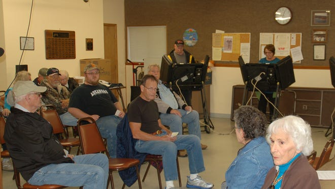 Voters are shown waiting to vote in Bull Shoals today.