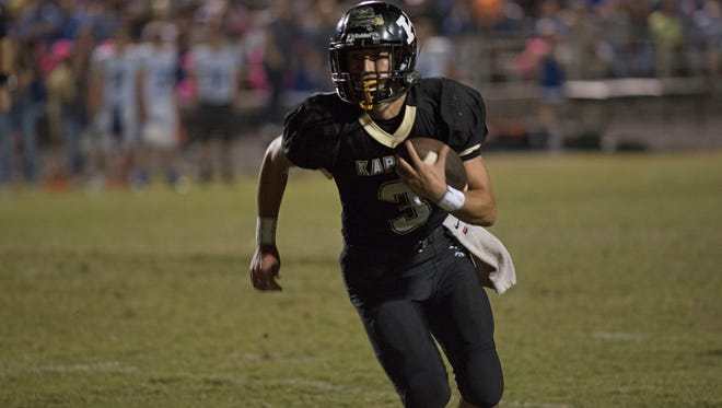 Senior quarterback Daniel Lotief runs the ball early in the first quarter of Kaplan's district clash with rival Erath.