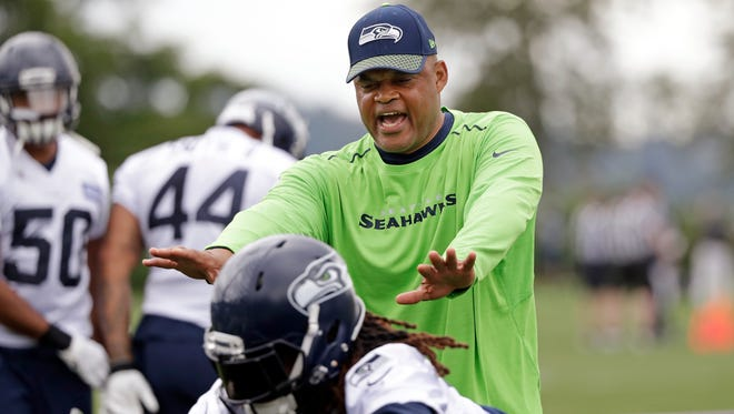 Seahawks defensive coordinator Ken Norton Jr. directs players during an NFL football practice Thursday in Renton.