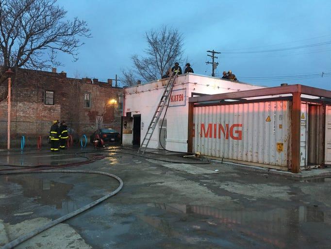 Firefighters on the scene at Katoi restaurant in Detroit's