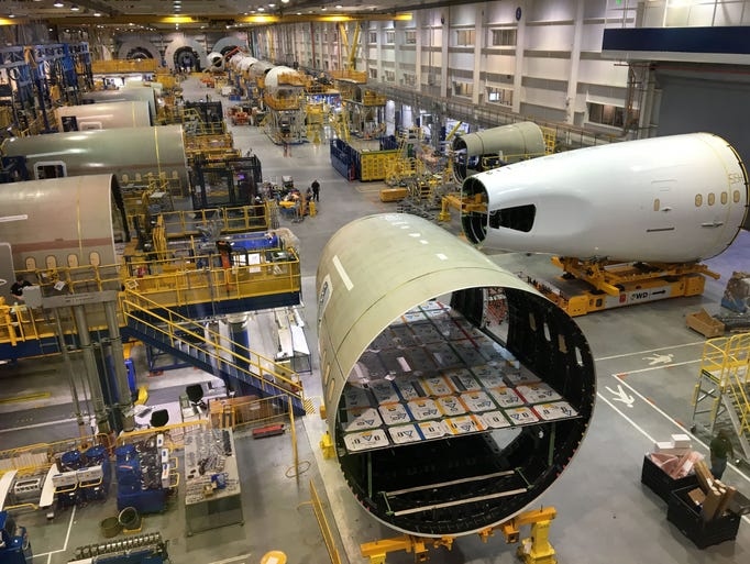 Portions of Boeing Dreamliner fuselages are worked