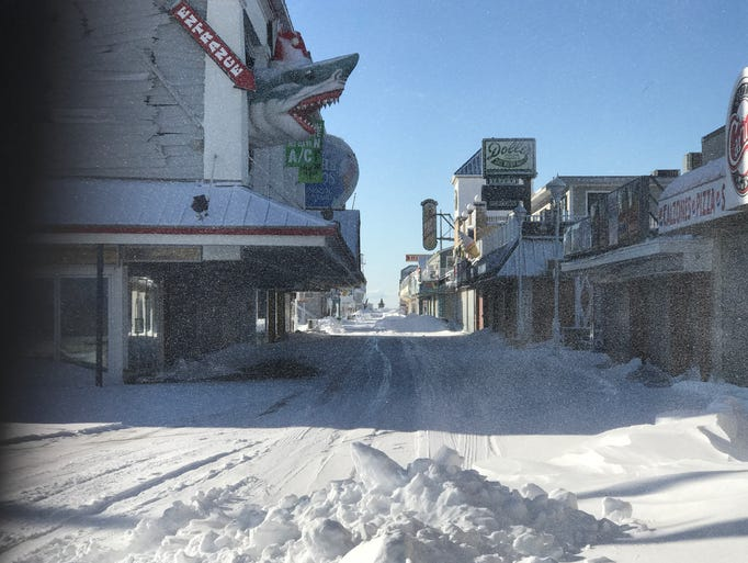 The Ocean City Boardwalk is still covered in snow Friday