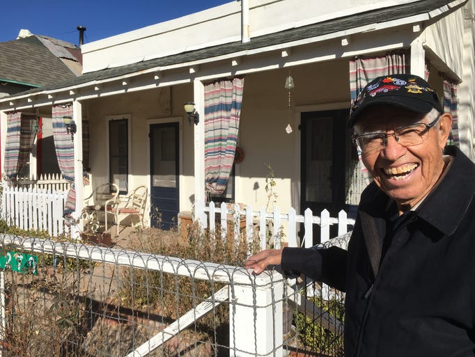 Angel Delgadillo stands outside his childhood home