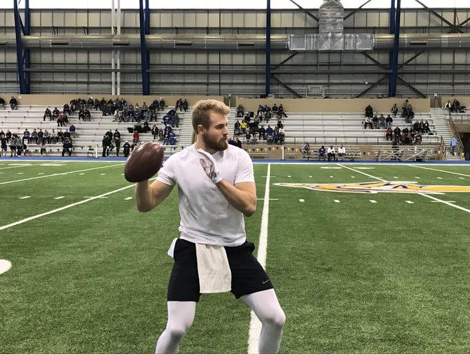 USD quarterback Chris Streveler warms up before drills